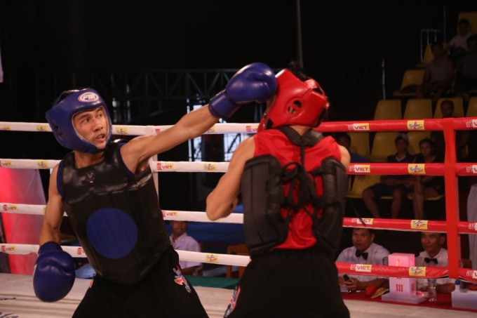 Huỳnh Hữu Đường (xanh) mong muốn được về thi đấu trận chung kết trên quê hương Quảng Ngãi của mình.