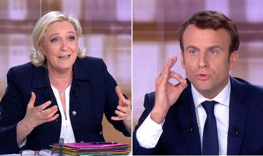 Đối thủ cực hữu Marine Le Pen và ứng cử viên độc lập Emmanuel Macron (phải).