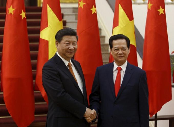 Tổng bí thư, Chủ tịch Trung Quốc Tập Cận Bình hội kiến Thủ tướng Nguyễn Tấn Dũng tại Văn phòng Chính phủ chiều 5/11. (Ảnh: Reuters)