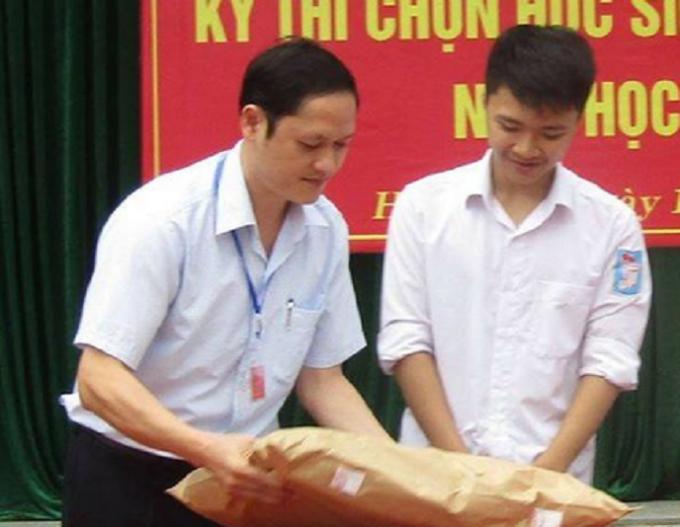 Ông Vũ Trọng Lương (bìa phải), bị khởi tố bị can vầ bắt tạm giam.