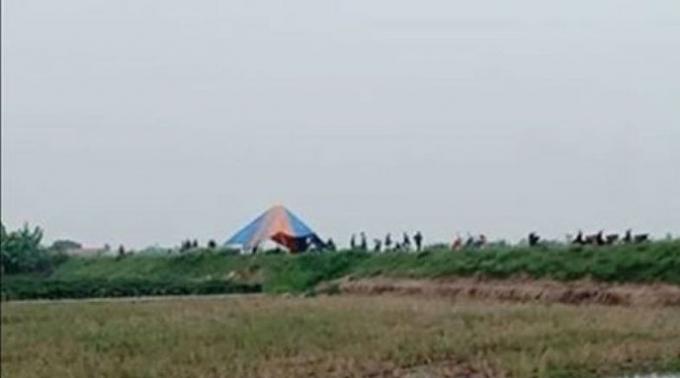 Khu vực cánh đồng phát hiện thi thể nạn nhân bị sát hại.
