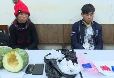 Pàng và Mang tại cơ quan điều tra.