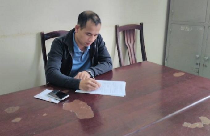 Tà xế Trần Quang Tuấn tại cơ quan điều tra.