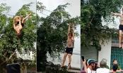[Clip]: Tưởng mình là khỉ, cô gái vắt vẻo đu bám trên dây điện
