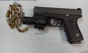 Hà Nội: Phát hiện súng quân dụng, đạn trong xế sang BMW