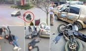 Kinh hoàng cảnh xe mô tô phân khối lớn tông ngang xe taxi làm 2 thanh niên bất tỉnh tại chỗ