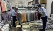 Phát hiện 3.459 sản phẩm quần áo giả mạo nhãn hiệu nổi tiếng tại Quảng Bình và Bắc Ninh