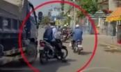 [Clip]: Tài xế xe tải đuổi ép xe máy khi đang chờ đèn đỏ khiến nhiều người bức xúc