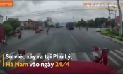 [Clip]: Người phụ nữ hồn nhiên tạt đầu xe container khiến tài xế hoảng hồn