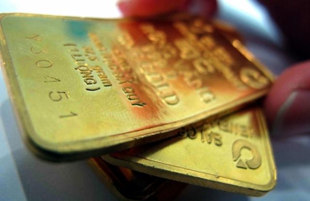 """Giá vàng hôm nay 25/7: Vàng thế giới vọt ngưỡng 1.900/ounce, giá vàng trong nước có thể tăng """"sốc"""""""